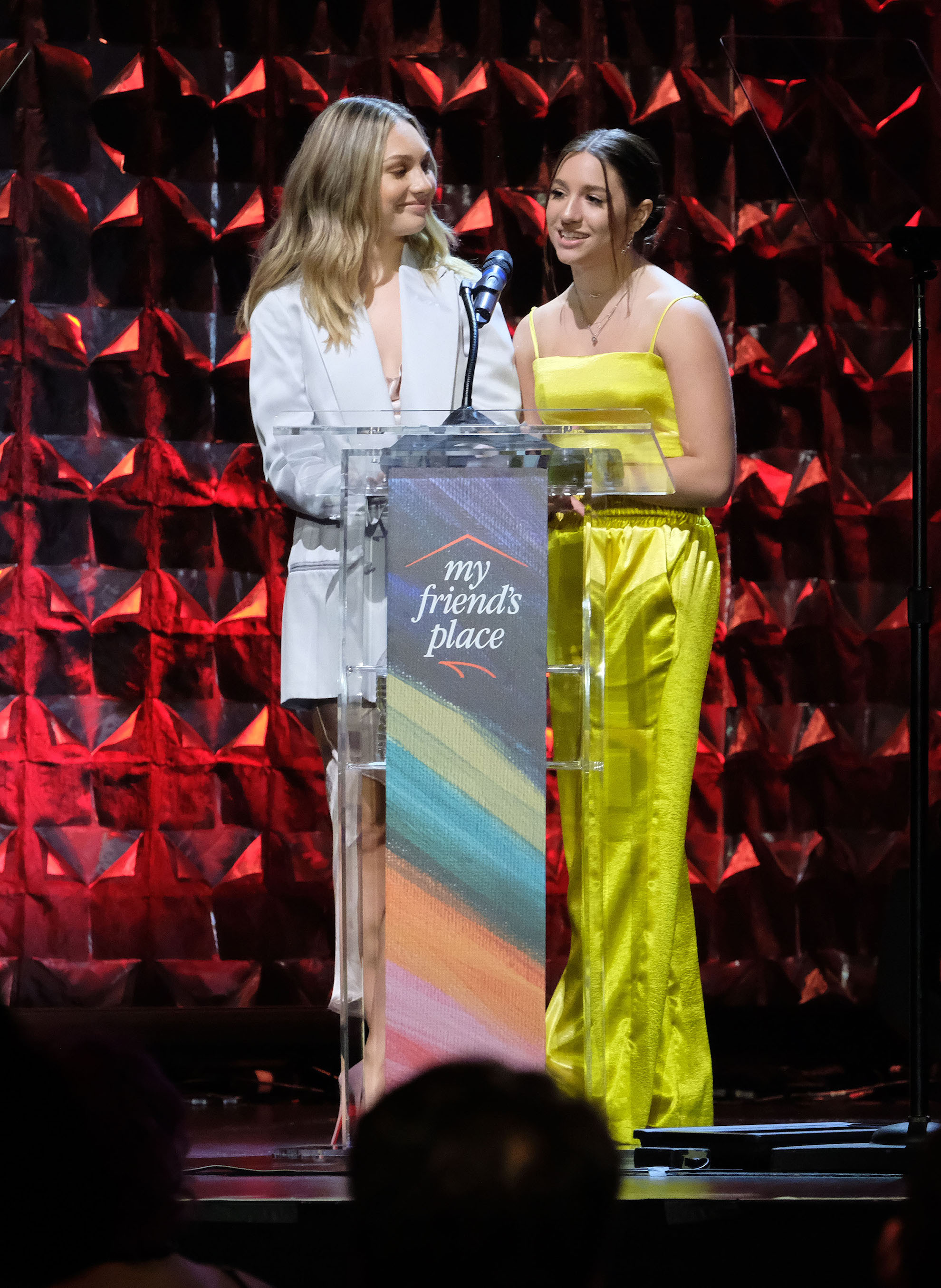 Maddie & Kenzie are honored as 'My Friend's Place' Champions of the